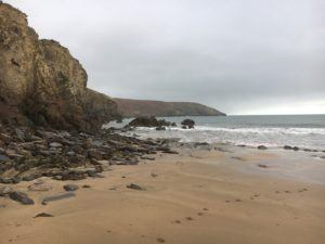 Rocky Bay beach, cliffs to the left