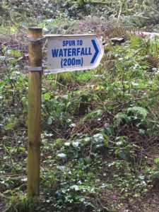 Ballard waterfall, sign posting down in the hollow